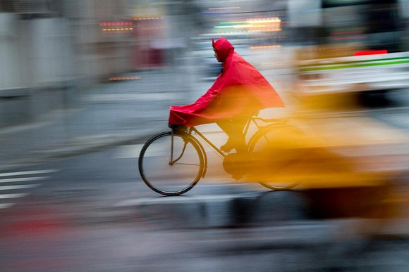 Cyclist riding in the rain in Shanghai